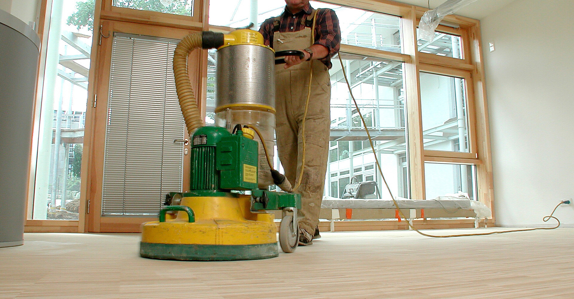 hired floor sander in use with man