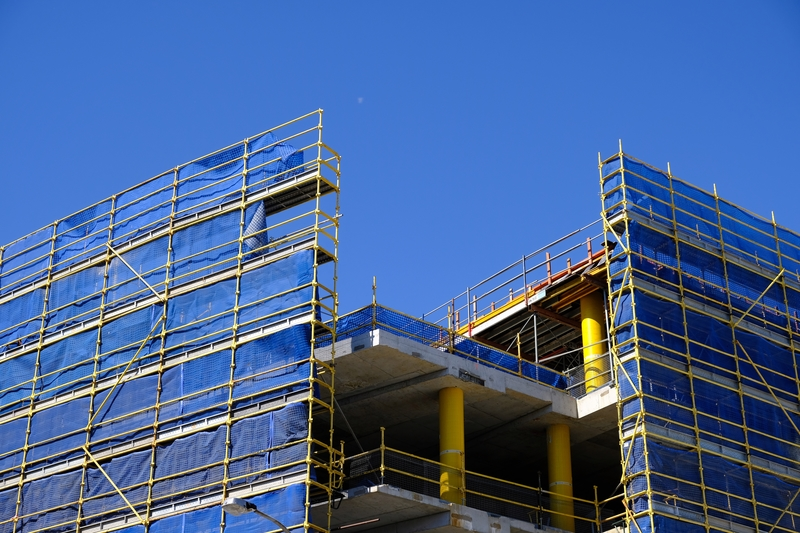 scaffolding with blue mesh