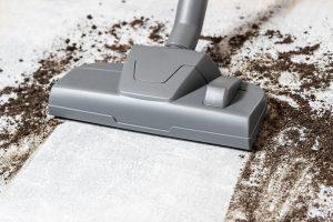 hoovering a dirty floor